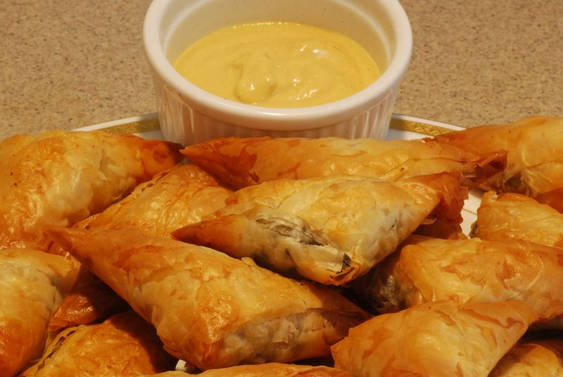 Spanakopitas Served with Dijon Mustard