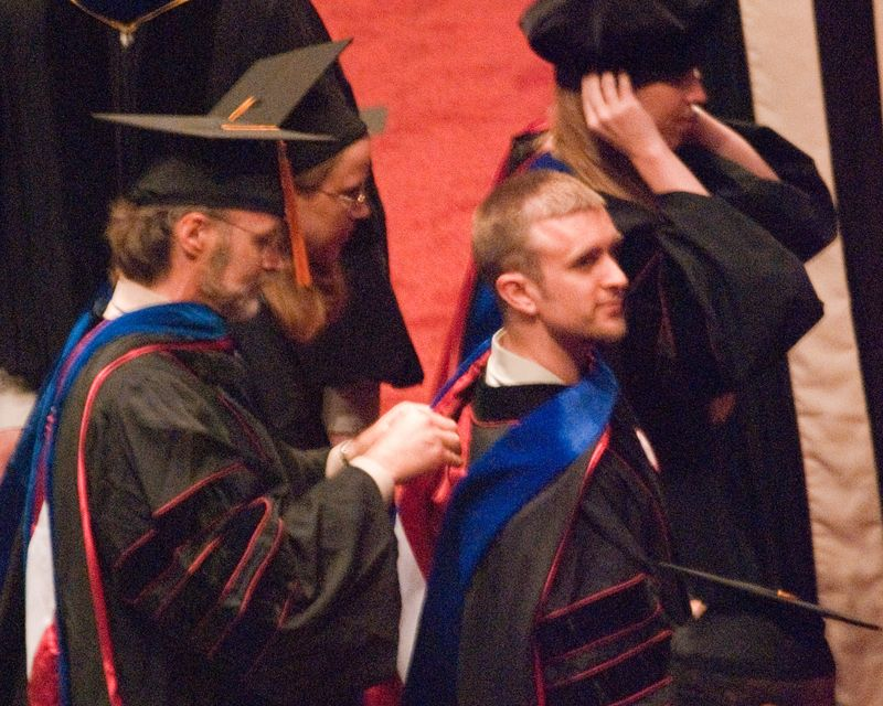 Hooding Dr. Holmes