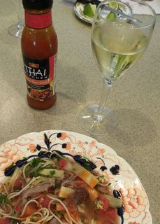 Vietnamese Duck Soup served with Thai chili sauce, lime wedges and a crisp, chilled white wine.