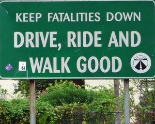 """Drive, Ride and Walk Good"" Sign"