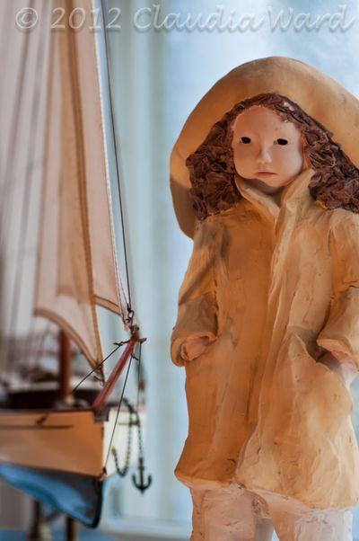 Girl in Rain Gear and a Ship