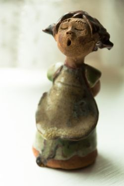 Figurine with green color cast