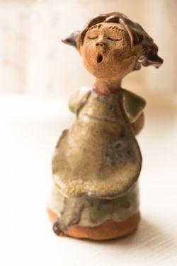 Figurine with orange color cast